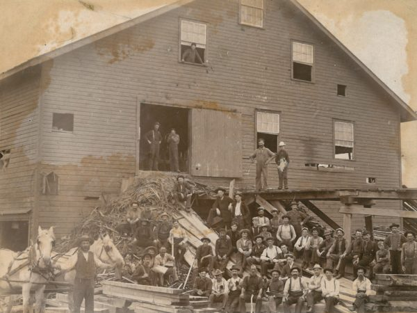 Workers in front of Sullivan's Lumber Mill in Canto