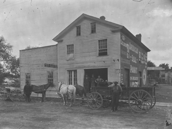 Men outside the Main Street Blacksmith Shop in Canton