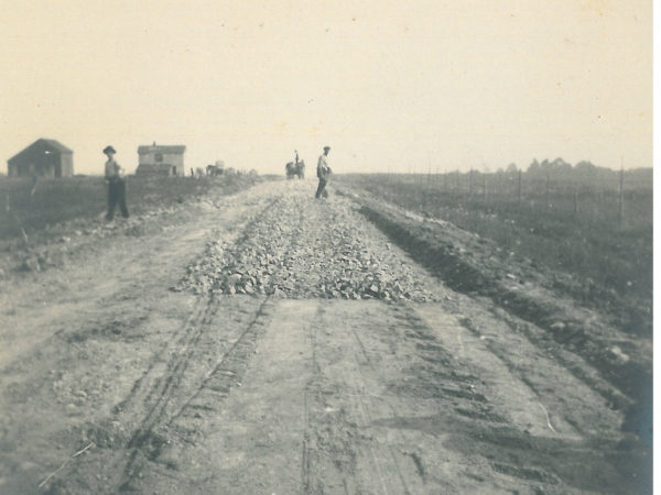 Laying crushed stone for a road in Saint Lawrence