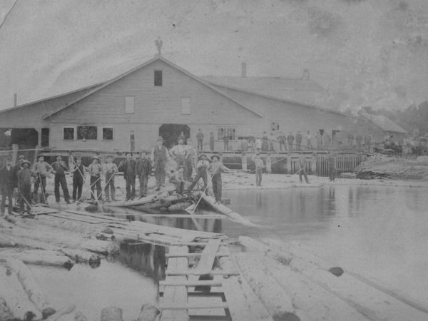 Employees and loggers in front of Sherwin Lumber Mill in Canton