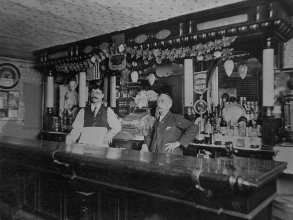 Menard and Erwin behind the bar at the Erwin House Bar in Canton