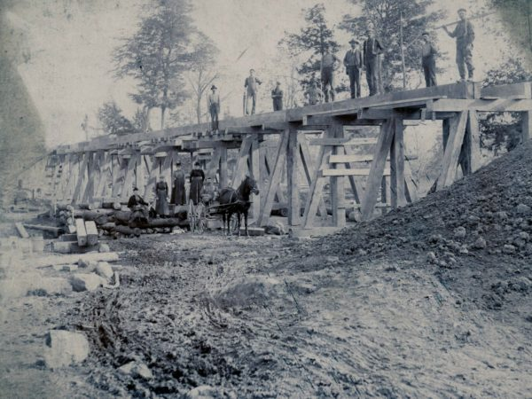 Construction of a trestle bridge in the town of De Kalb