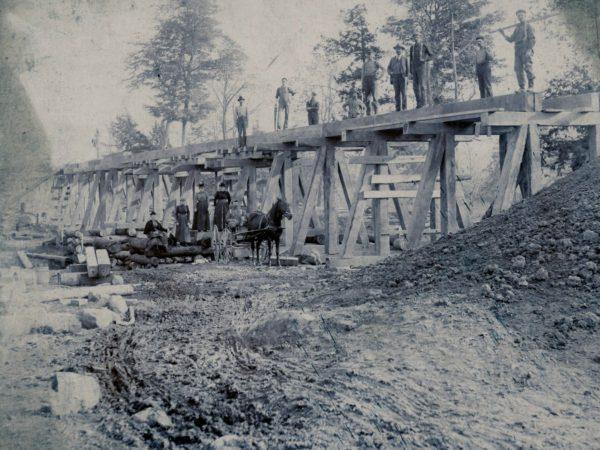 Construction of a trestle bridge in the town of De Kalb