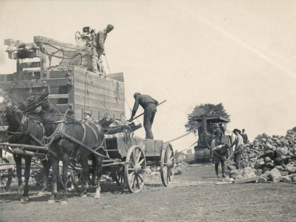 Crushing stone to Build a road using a steam powered stone crusher in Hermon