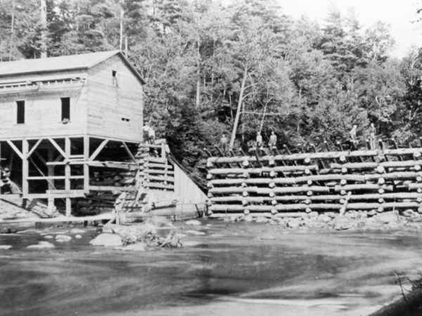 Chambers men building a dam on the St. Regis River in Lawrence