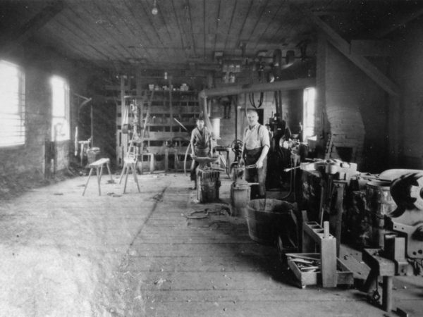 Blacksmiths at work inside their shop in Hammond
