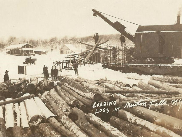 Loading logs onto a railroad car with a steam winch in Newton Falls