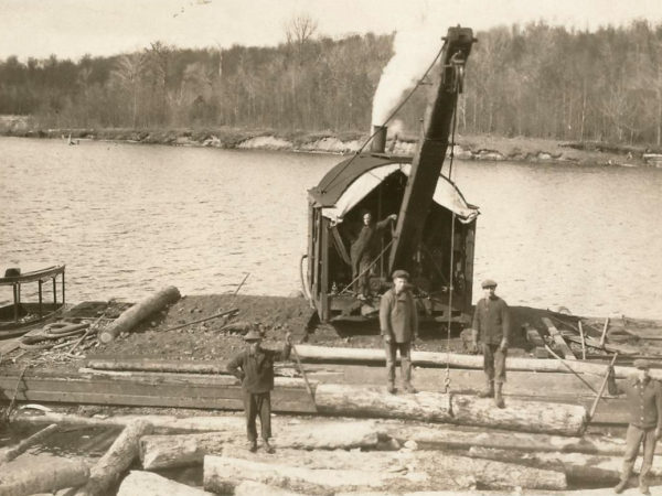 Barnhart Loader moving logs at Chair Rock Bay in Cranberry