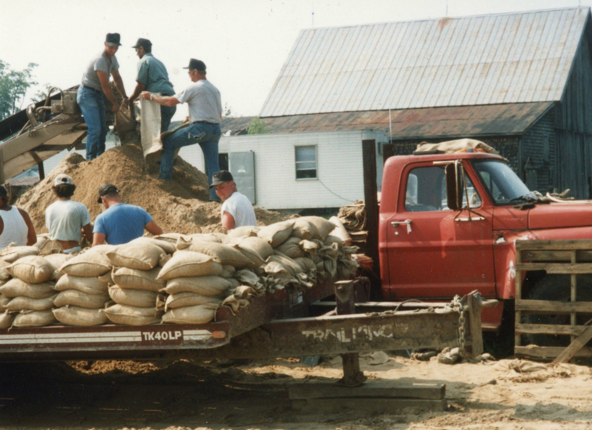 Filling And Stacking Bags Of Dirt For Construction The