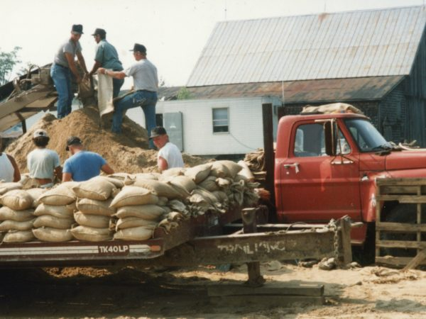 Filling and stacking bags of dirt for construction of the Iroquois Pipeline in Hermon