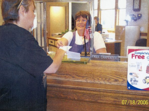 Connie Green working as a bank teller in the Hermon Community Bank in Hermon
