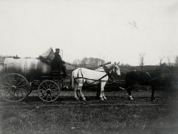 Horse drawn oil delivery wagon in Hermon