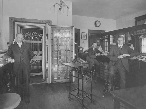 Three male tellers inside the Lake Champlain National Bank in Westport