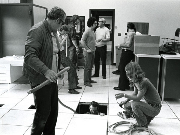 Employees of computing services at SUNY Potsdam installing a mainframe computer in Potsdam