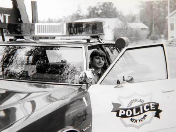 Officer Tom Proulx in a Tupper Lake Police Department vehicle in Tupper Lake