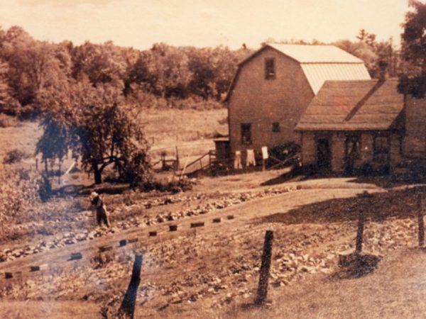 Farmer Warren Dake on the Dake Homestead in Oak Point