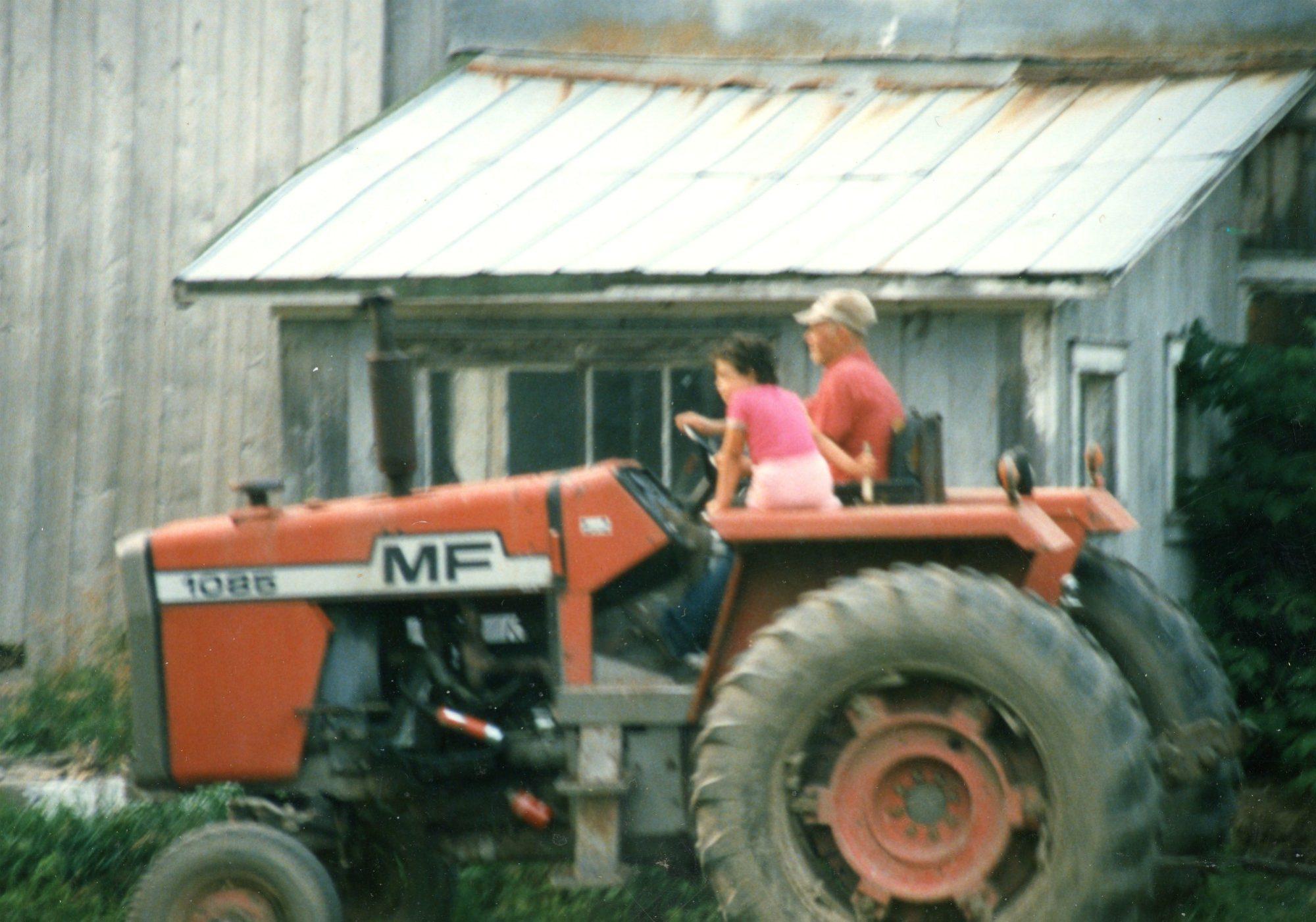 Driving a Massey Ferguson 1085 tractor on the Cuthbert Farm in Hammond