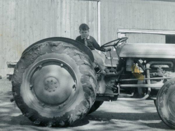 Child on farm tractor on Cuthbert Farm in Hammond