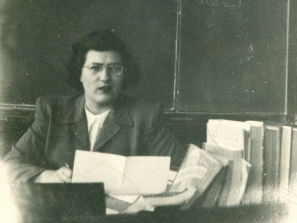Teacher Doris Erdman at her desk in Hammond