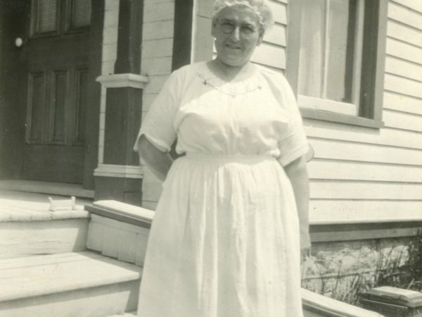 Nurse Patchen outside of a home in Hammond