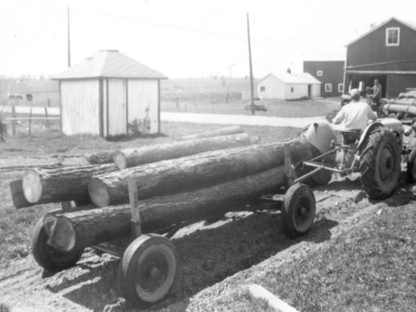 Hauling logs with a Ford tractor on the Paddock farm in Hammond