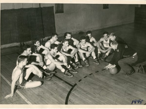 Clarkson basketball team with Coach Hank Hodge in Potsdam