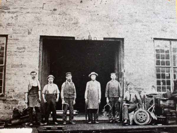 Portrait of workers outside a foundry in Potsdam
