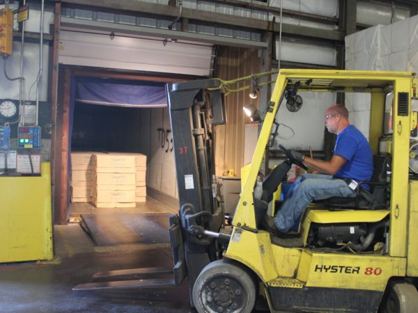 Preparing to forklift paper at the Potsdam Specialty Paper Company in Potsdam