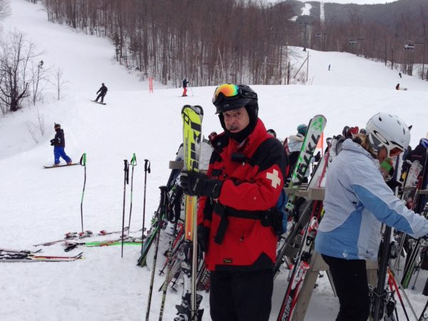 Ski patroller Rick Wood holds skis on Whiteface Mountain in Wilmington