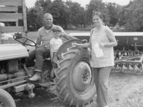 Hadlock family with their tractor on their dairy farm in Hammond
