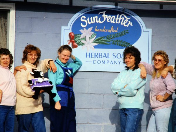 Employees in front of Sunfeather Soaps in Parishville