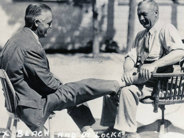 Doctor Locke treating adjusts a man's feet in Williamsburg