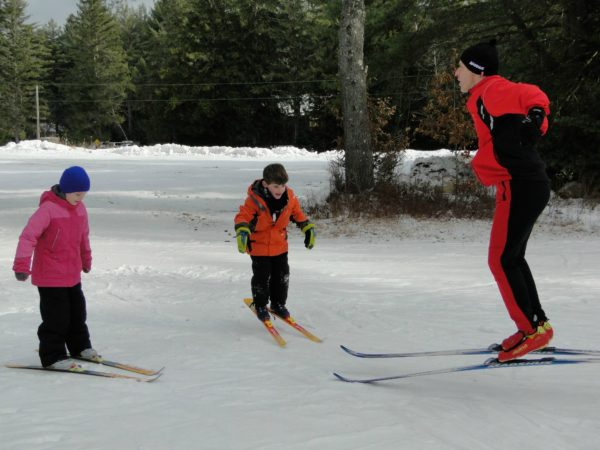 Oaul Ferri teaching children to nordic ski in Benson