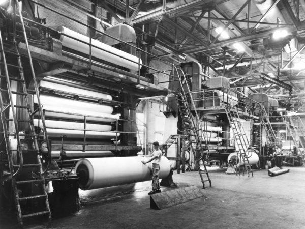 Worker at a super calendar machine at the St. Regis Paper Company mill in Deferiet