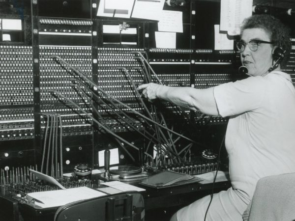 Erma Scholl working a telephone operation switchboard in Old Forge