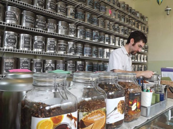 Ben Kemp at the counter of Sensibiliti Teas at The Shirt Factory in Glens Falls