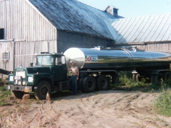 Bill Hull in front of his milk truck in Lisbon