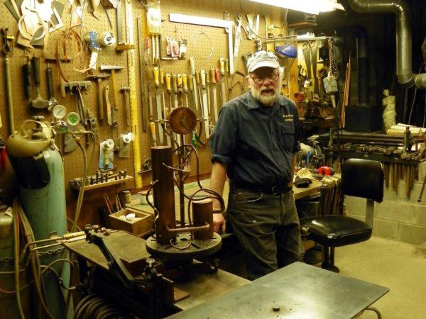 Malcolm Owen inside of his metalworking studio in Pierrepont