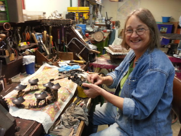 MaryAnn Owen in her metalworking shop in Pierrepont