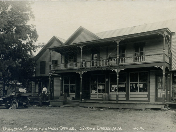 Man and automobile outside Dunlop's Store and Post Office in Stony Creek