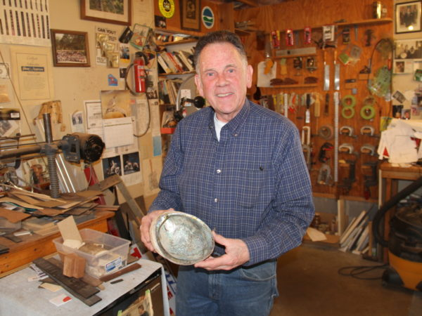 Dave Nichols holding a shell he uses to inlay guitars
