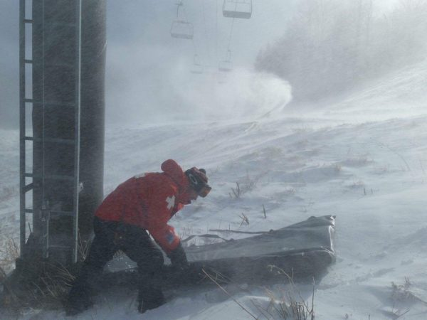 Ski patrol director gets slopes ready for skiing at Whiteface Mountain in Wilmington
