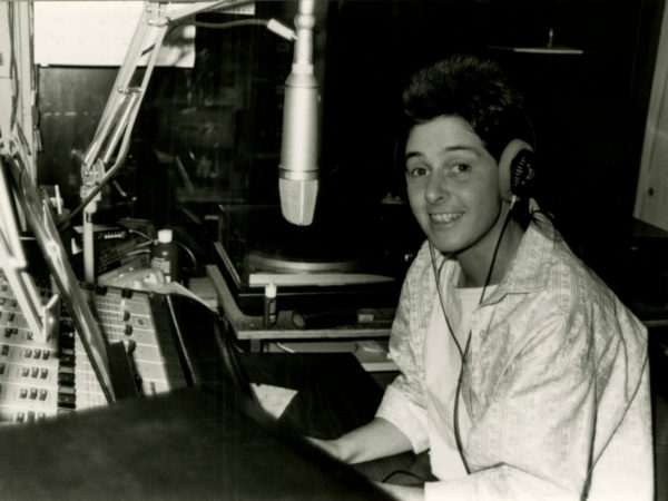 WSLU announcer in the control room in Canton