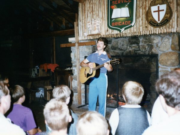 Keith Miller plays guitar at a worship service at Northern Frontier Camp in North River