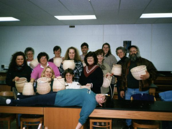 Patty Farrell teaches with basket weaving class in Ogdensburg