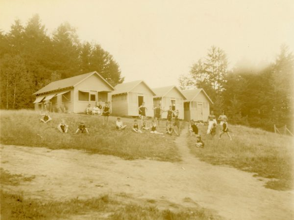 Children in front of the bunks at Camp Beattie in Long Lake