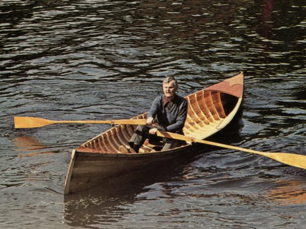 Fred Burns rowing a guide boat in Long Lake