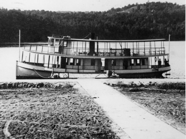 Steamboat tied up at the village dock in Long Lake