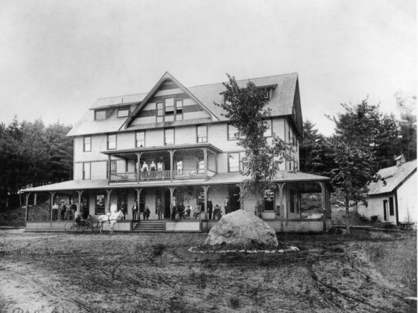 Employees on the porches of the Adirondack Hotel in Long Lake