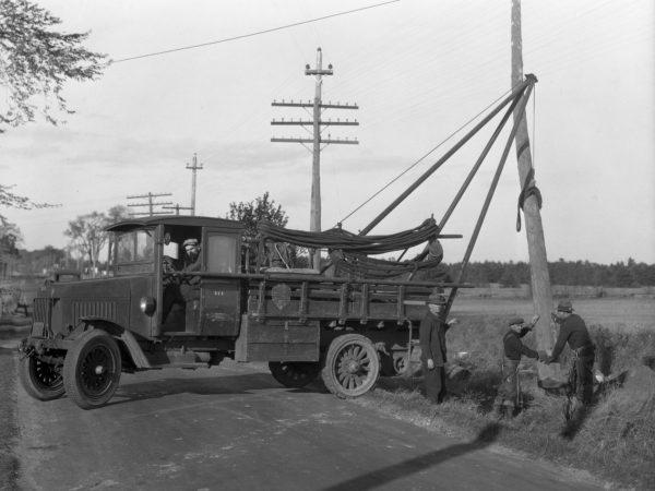 Mountain Home Telephone Company erect telephone pole.in Clinton County